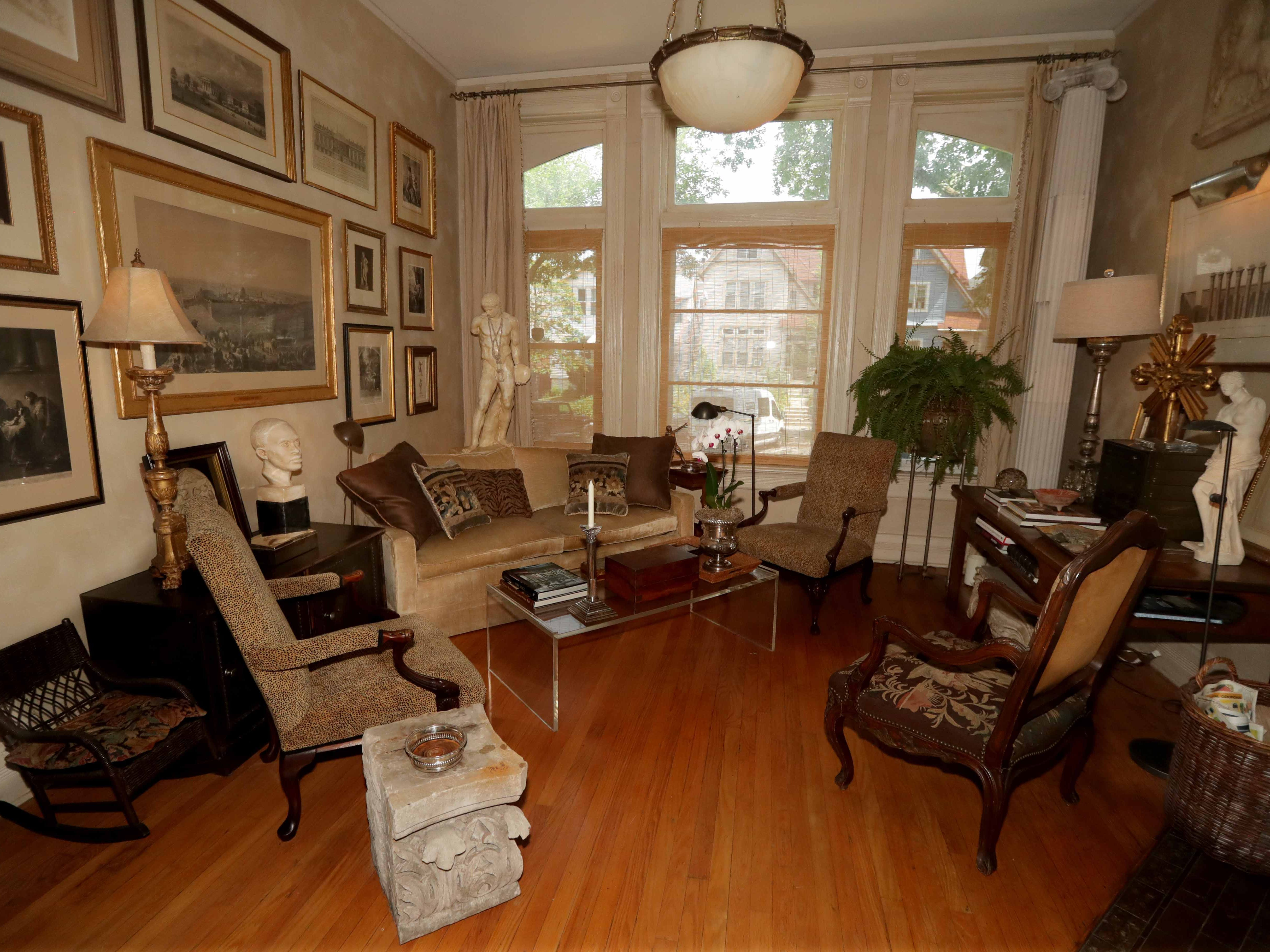 Just off the entry to the home is the front parlor with large windows facing the street.