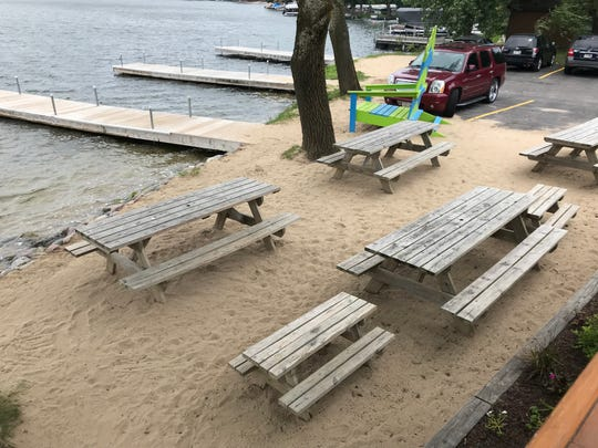 The Foolery's patio even has its own beach.