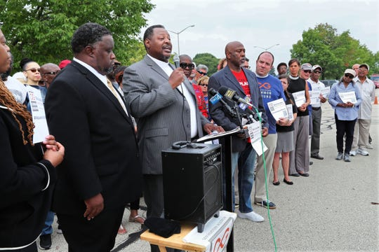 The Rev. Demetrius Williams of Community Baptist Church in Milwaukee (with microphone) and the Rev. John K. Patterson of Mt. Olive Baptist Church in Milwaukee (left) appear at a Common Ground news conference across the street from the Waukesha County Courthouse. The group is investigating a possible case of racial profiling of the two black ministers, who had a flat tire along I-94 in Waukesha County.