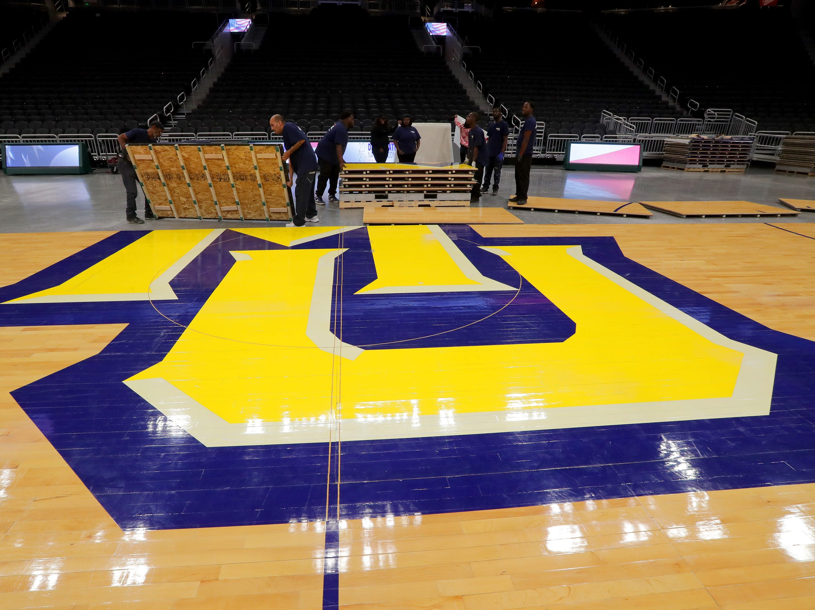 Work is done to install the Marquette floor. The Marquette mens' basketball team locker room is complete at the new Fiserve Forum, the home of the Milwaukee Bucks. Monday, August 27, 2018.  -  Photo by Mike De Sisti / Milwaukee Journal Sentinel