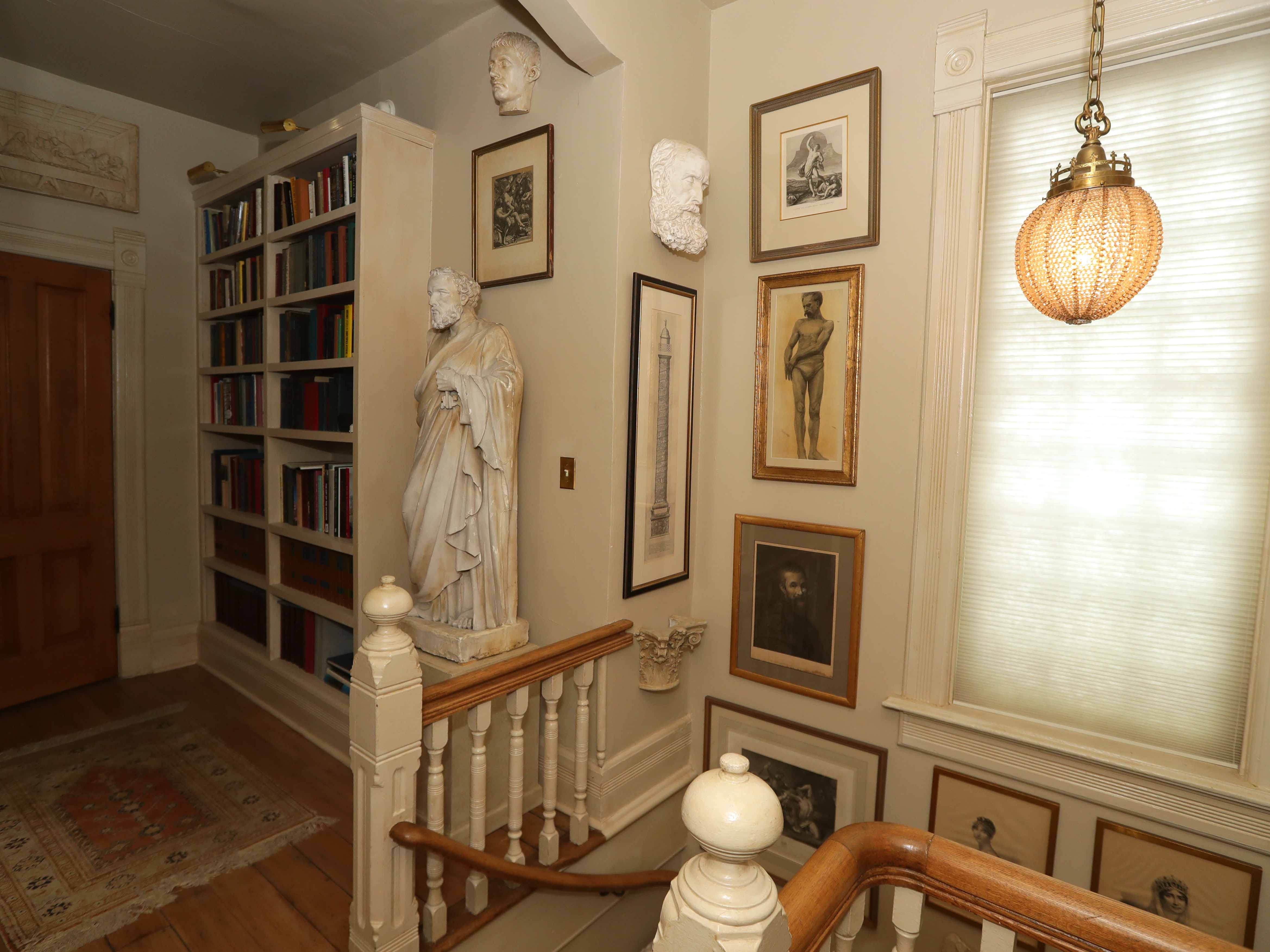 Plaster statues and busts such as these on the second floor are featured throughout the home.