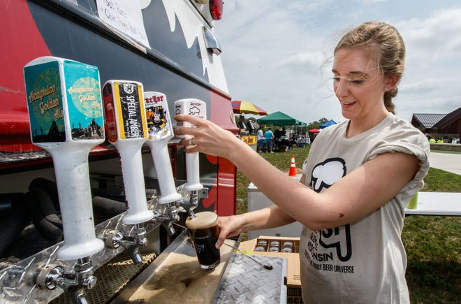 City of Glendale employee Anna Voigt taps a Sprecher Root Beer during the second annual Root Beer Bash at Richard E. Maslowski Community Park in Glendale in 2018. This year's Root Beer Bash is Aug. 28. .
