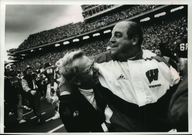 Badgers Coach Barry Alvarez and band director Michael Leckrone celebrate the 13-10 victory over Michigan at Camp Randall Stadium in 1993.