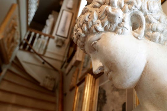 This bust sits at the bottom of the staircase leading to the second floor.