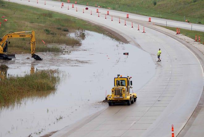 Crews work on a flooded I-43 at Highway 32 near Port Washington on Monday.