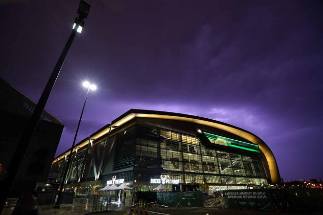 Lightning flashes above the Fiserv Forum, the new home of the Milwaukee Bucks on Sunday evening. The storms held off long enough, as earlier in the day the public got their first look at  the new arena on Sunday