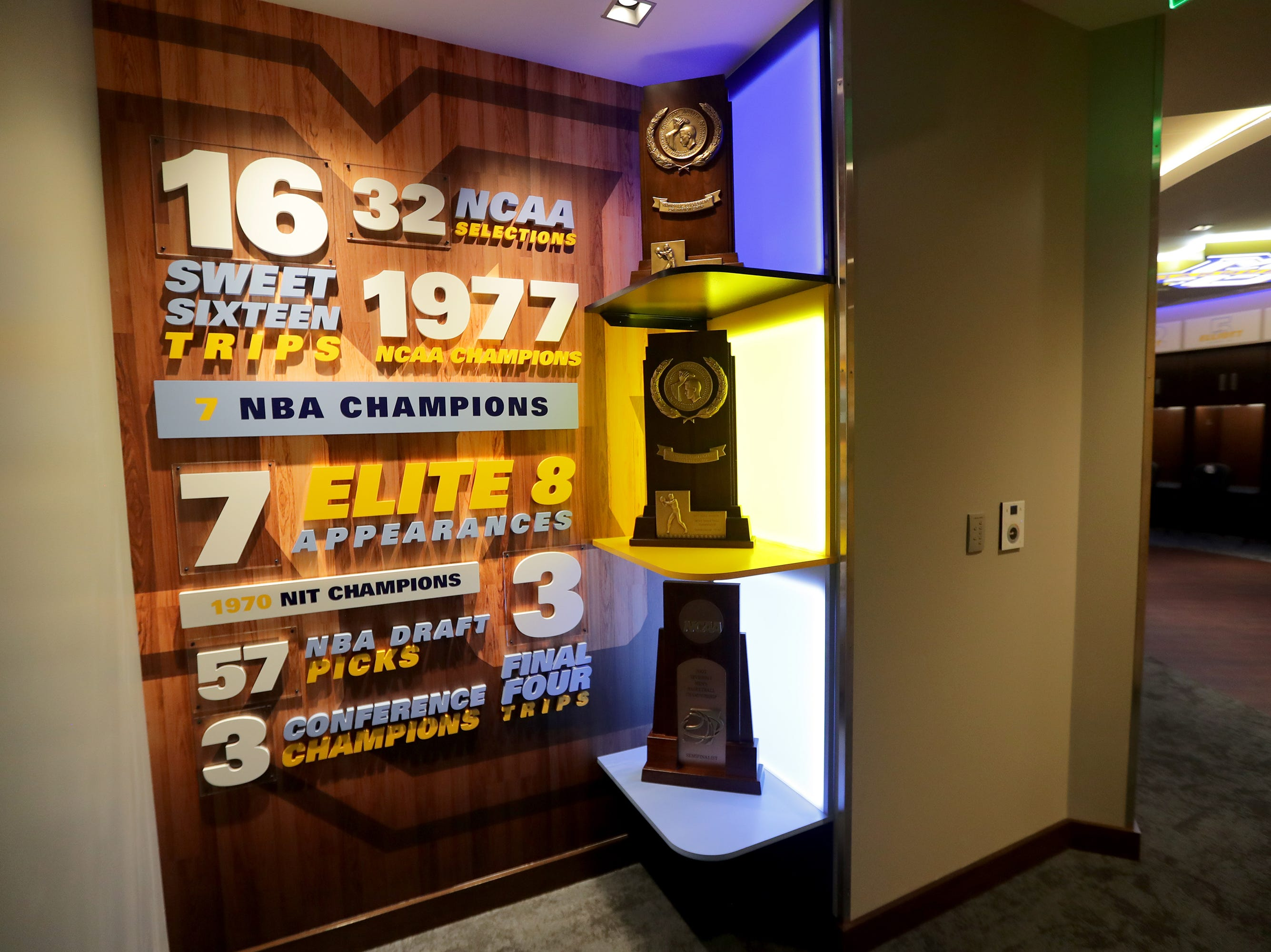 Trophies and championship signage are are featured as you enter the locker room.  The Marquette mens' basketball team locker room is complete at the new Fiserve Forum, the home of the Milwaukee Bucks. Monday, August 27, 2018.  -  Photo by Mike De Sisti / Milwaukee Journal Sentinel