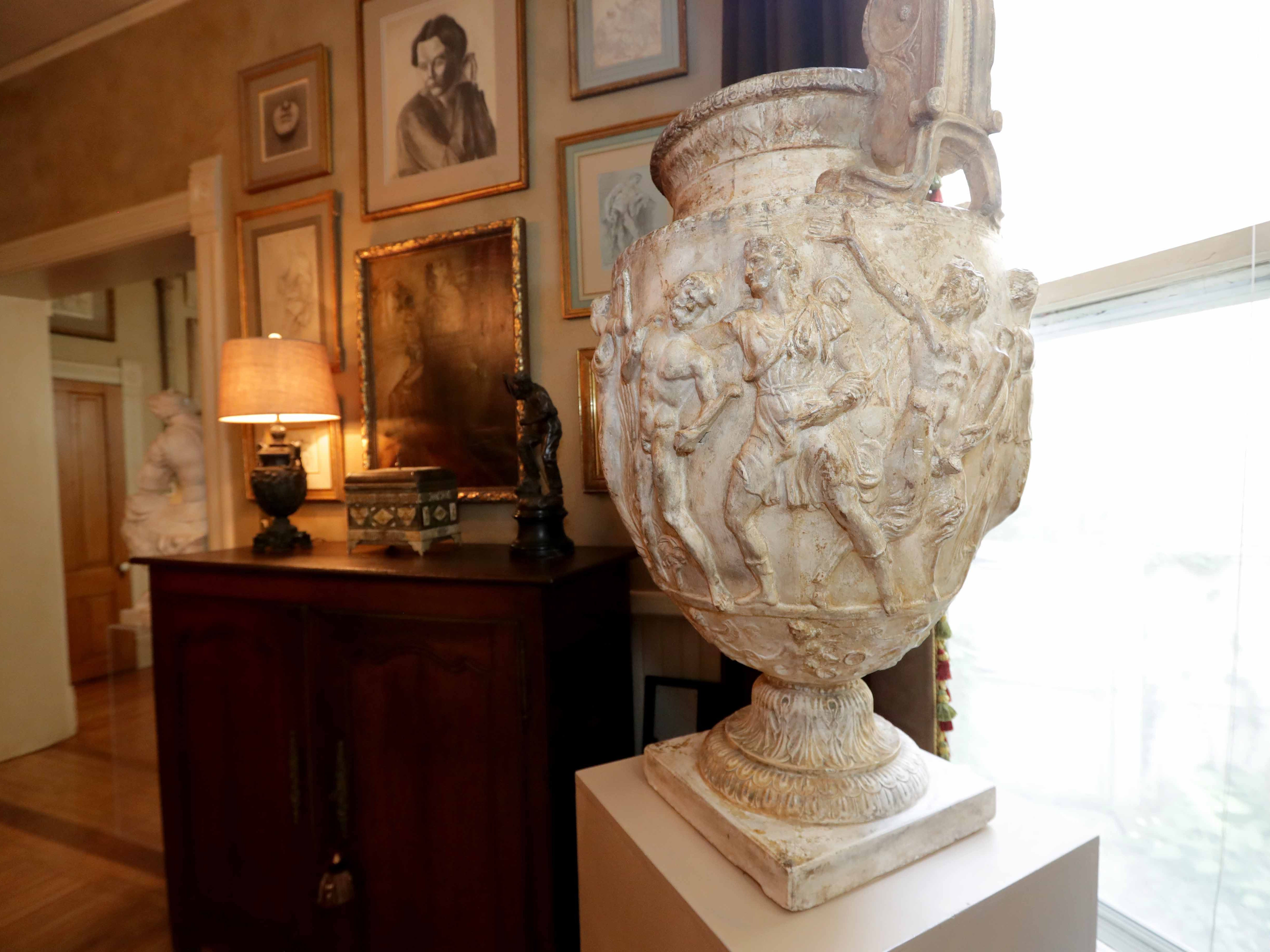 A large 19th-century vase in the dining room is a copy of a vase that discovered in ruins in a villa south of Rome.