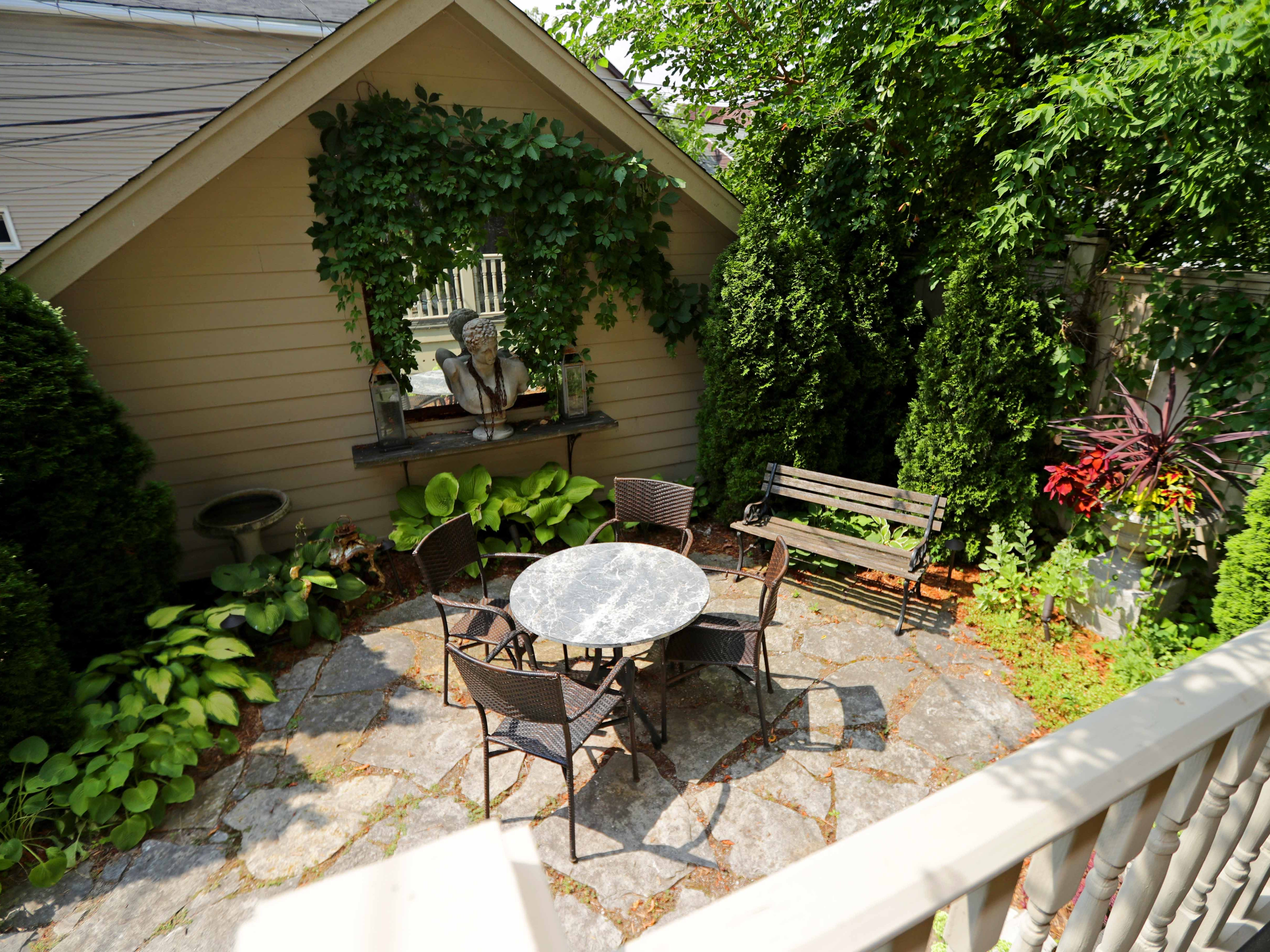 A cozy patio is located off the back of the house.
