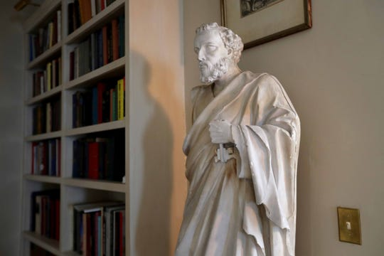 This plaster statue of St. Peter was never painted but was probably meant to be put in a church, according to homeowner Gene Berube.