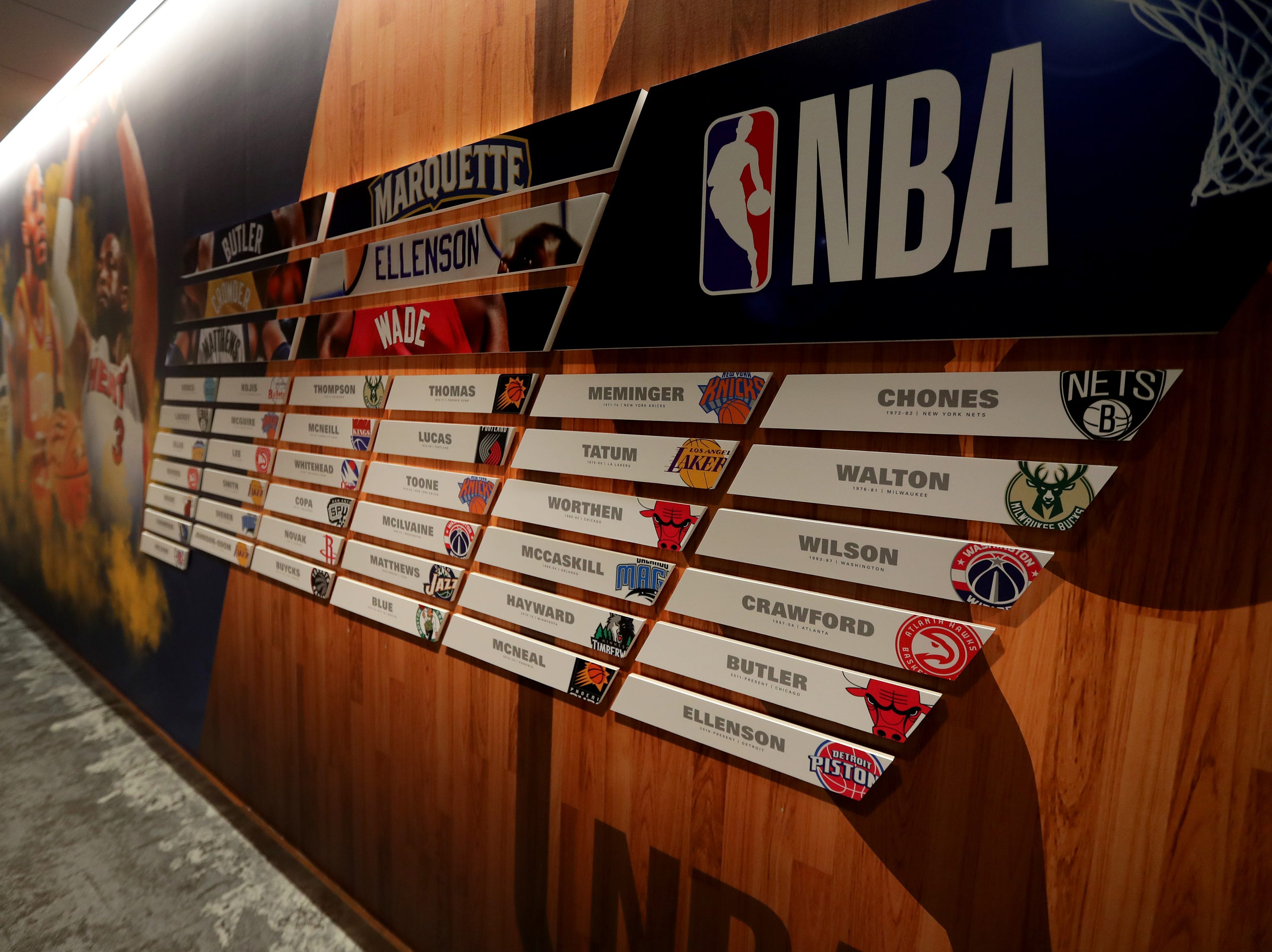 A wall leading to the coaches office features logos with names of current NBA players who played for Marquette. The Marquette mens' basketball team locker room is complete at the new Fiserve Forum, the home of the Milwaukee Bucks. Monday, August 27, 2018.  -  Photo by Mike De Sisti / Milwaukee Journal Sentinel