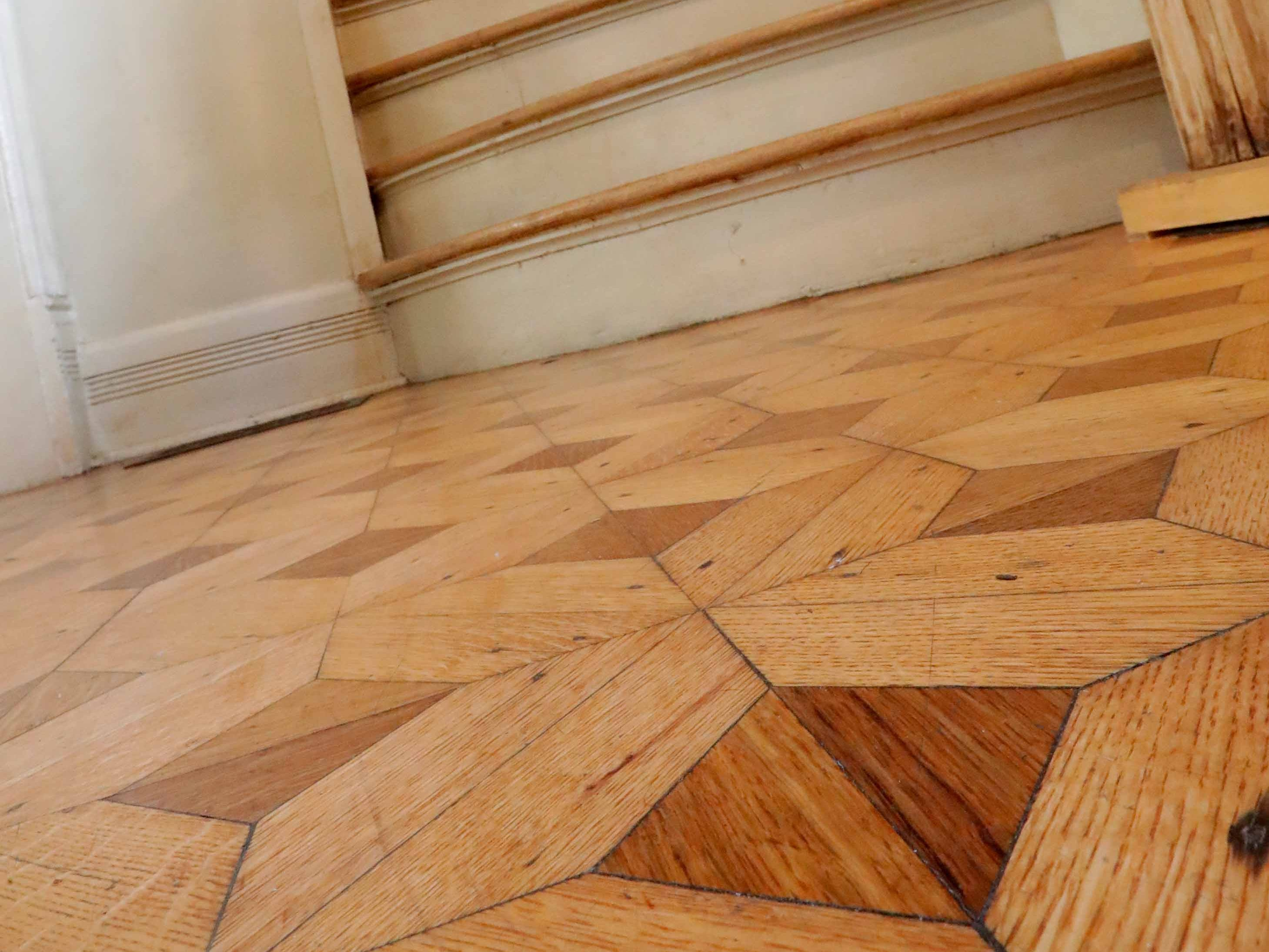 Parquet flooring greets visitors in the entryway.