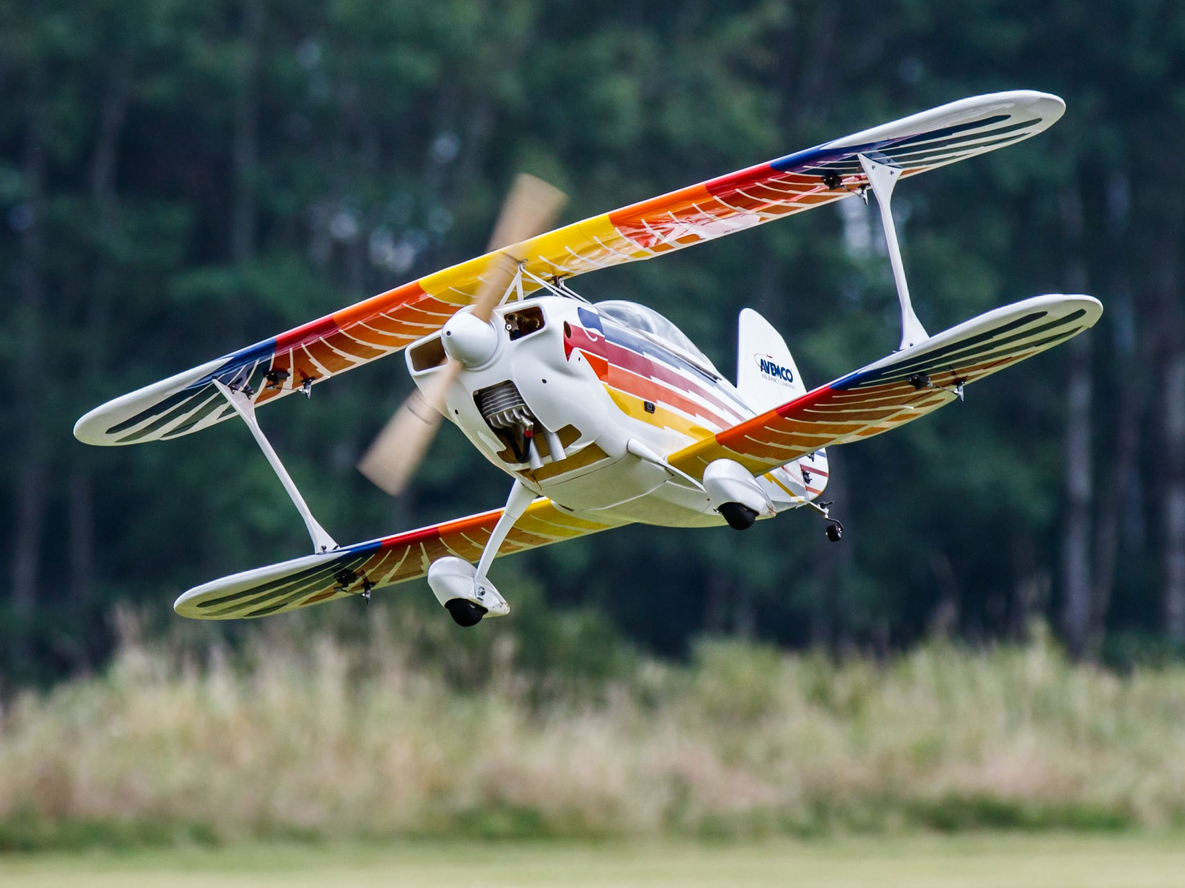 A beautifully detailed Christen Eagle II aerobatic biplane owned by Tom Jacobs of Menomonee Falls takes flight during the Flying Electrons Radio Control Airfest 2018 in Menomonee Falls on Saturday, August 25, 2018.