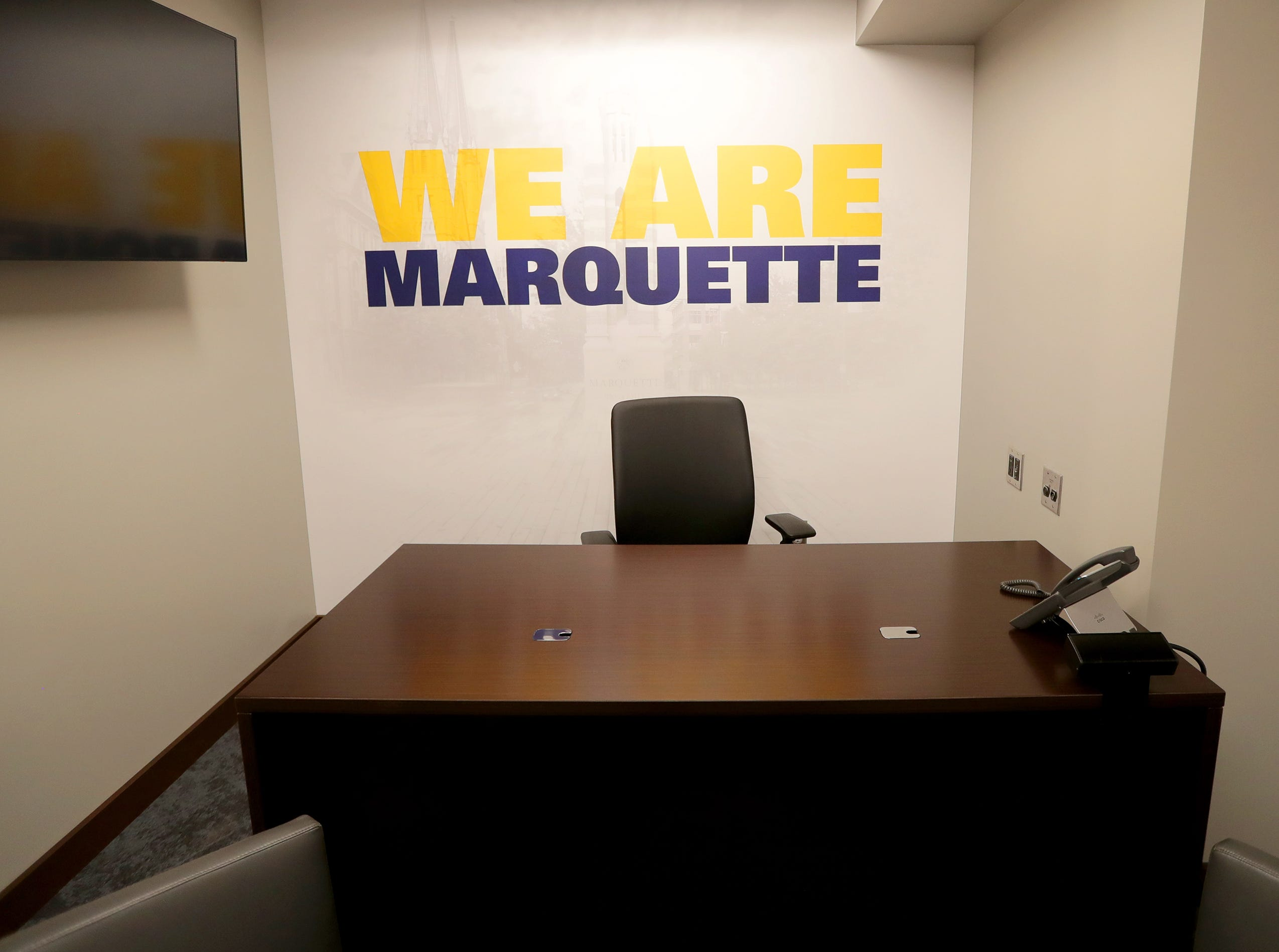 The desk in the office of the head coach, Steve Wojciechowski is down the hall from the locker room. The Marquette mens' basketball team locker room is complete at the new Fiserve Forum, the home of the Milwaukee Bucks. Monday, August 27, 2018.  -  Photo by Mike De Sisti / Milwaukee Journal Sentinel