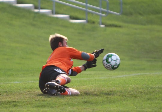 Greenfield goalkeeper Jesse Sponholz makes a diving save in a game against Shorewood on August 27.