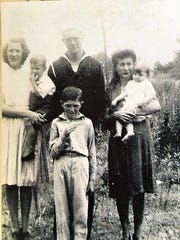 John Burgamy, the younger man standing in the front, with his siblings James, Ruby, Jenny, Sarah and Robert. He was one of eight children.