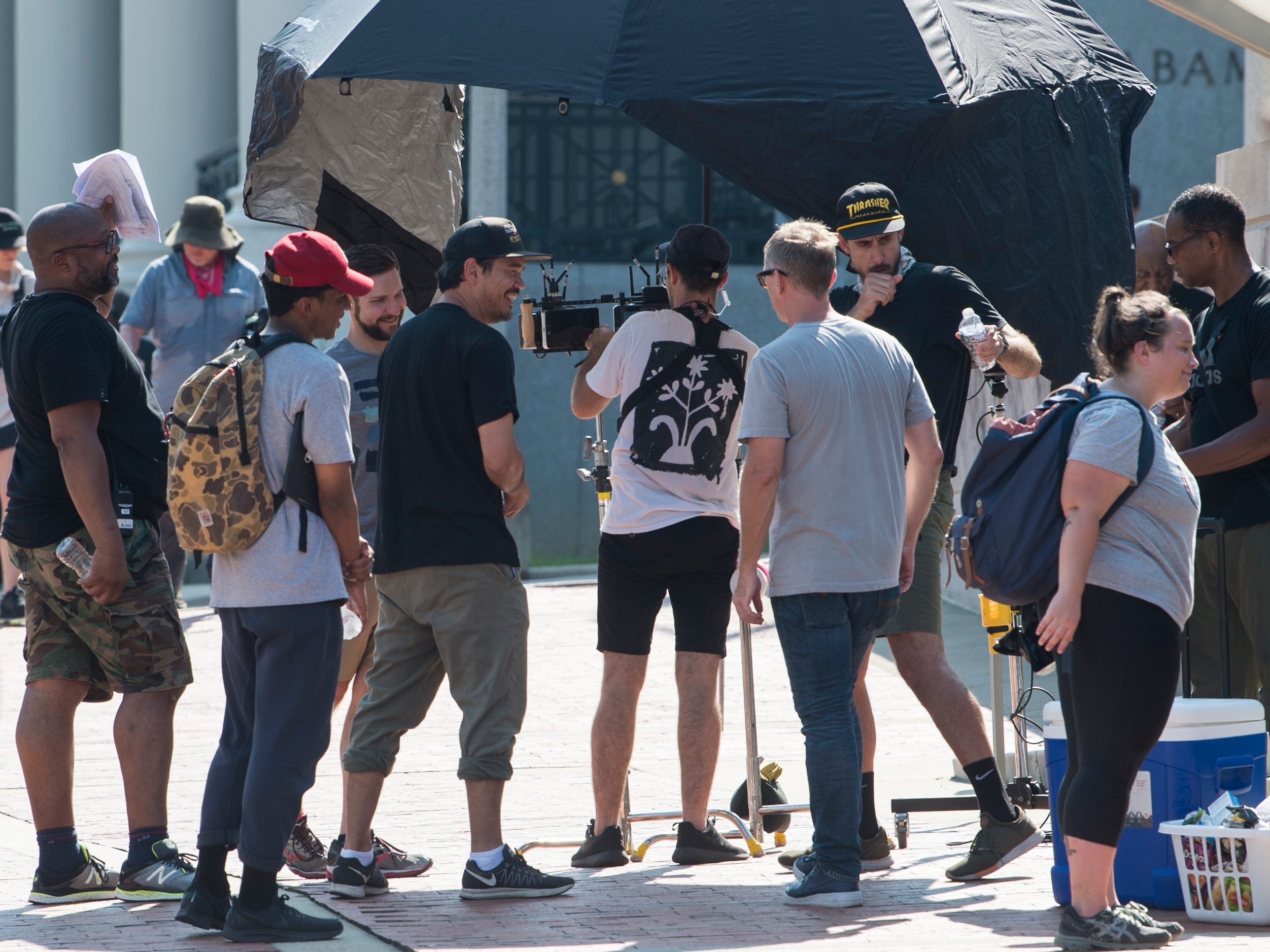 Director Destin Daniel Cretton, middle left, jokes with his crew as they film scenes for 'Just Mercy' at the intersection of Dexter Ave. and Hull Street in Montgomery, Ala., on Monday, Aug. 27, 2018.