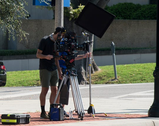 Cameramen set up shots as crews film scenes for 'Just Mercy' at the intersection of Dexter Ave. and Hull Street in Montgomery, Ala., on Monday, Aug. 27, 2018.
