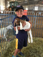 Wilson the goat, being held by Kolby Jordan, was born during the 2018 Wilson County Fair.