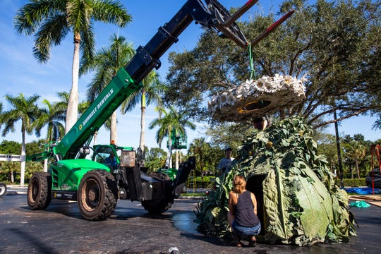 """""""The Four Seasons,"""" four outdoor fiberglass sculptures by American artist and filmmaker Philip Haas, are installed at Artis-Naples on Monday, August 27, 2018. The 15-foot busts, based on the quirky fruit and vegetable portraits by 16th-centuryÊpainter Giuseppe Arcimboldo, will officially open on Wednesday, September 5th."""