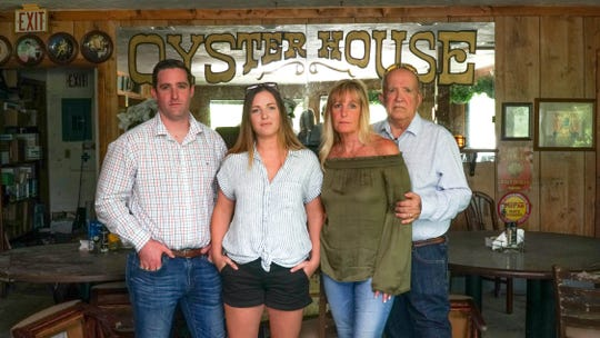 The Miller family, photographed this summer inside their former Osyter House restaurant in Everglades City, includes, from left,  James, Jillian, Patricia and Robert.