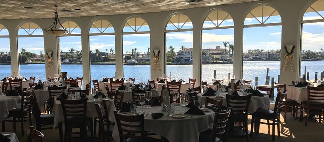 T-Michael's Steak & Lobster House has daily happy hours and waterfront dining with a view of Venetian Bay in Naples.