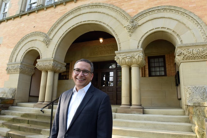 Denison University president Adam Weinberg in front of Doane Administration Building on the Academic Quad.