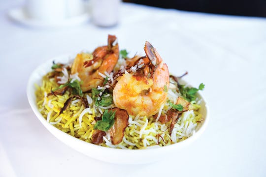 The shrimp dum biryani--shrimp cooked with basmati rice on a low fire with Indian herbs and spices--at the Bay Leaf restaurant in South Orange