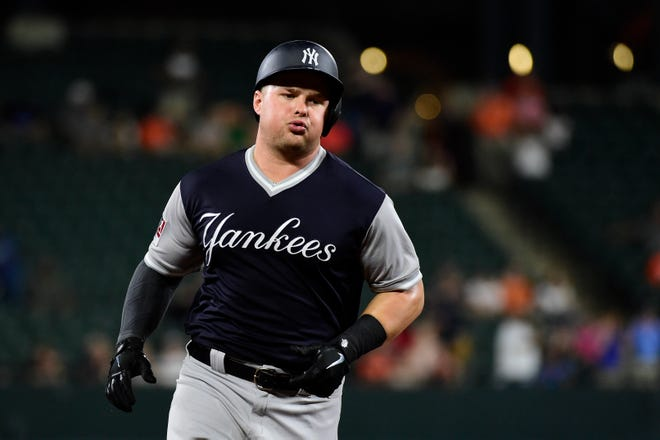 New York Yankees first baseman Luke Voit (45) round the base after hitting a two-run home run off .