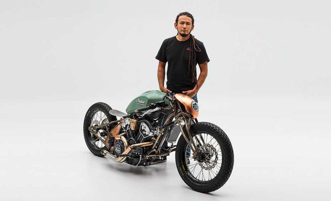 "Alfredo ""Fred"" Juarez stands with his winning Indian Motorcycle design."
