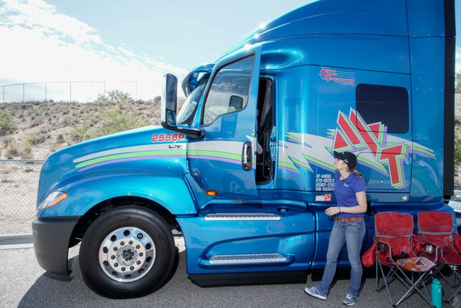 Cassidy Edmonds of Mesilla Valley Transportation assists visitors at the annual Touch-a-Truck event at Camino Real Middle School on Saturday, Aug. 25, 2018.