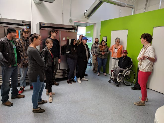 Kelly Egolf, right, owner of Verde Foods, leads Santa Fe Community College students on a tour of Verde Juice in 2017 in Santa Fe.