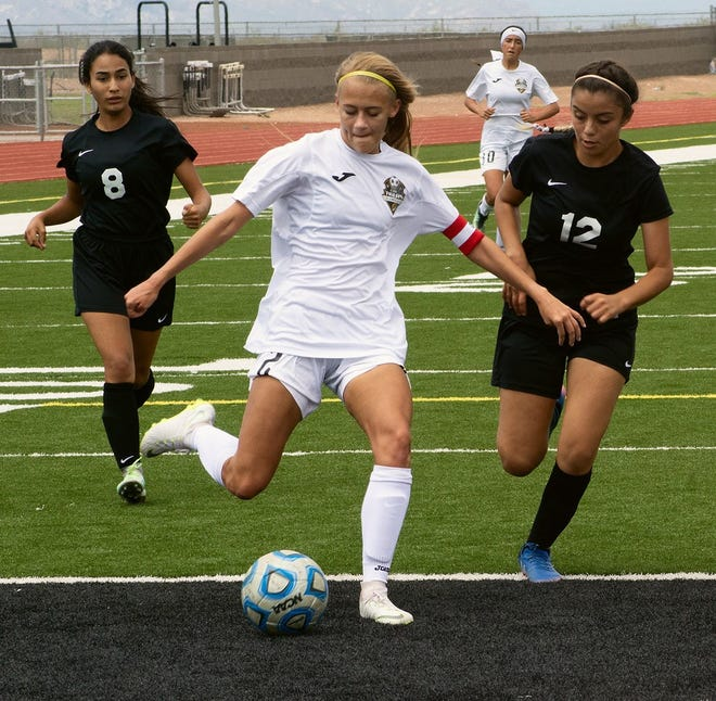 Lady Tiger Sheyenne Drake (2) holds off Chaparral Lady Lobo Karen Perches (12) as Drake prepare to send one of her two goals on its way to the back of the net in the Lady Tigers 10-0 victory.