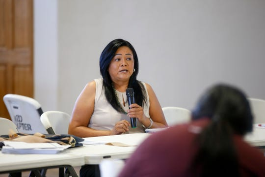 Karen Benally, department manager for the Department of Planning at the Navajo Division of Transportation, talks about how projects are selected for funding during a Tribal Transportation Improvement Program Public Hearing Monday at the Nenahnezad Chapter house.