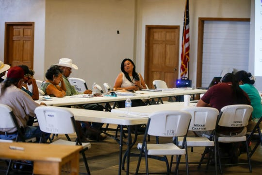 At center, Karen Benally, department manager for the Department of Planning at the Navajo Division of Transportation, participates in a public hearing about the Tribal Transportation Improvement Program Monday at the Nenahnezad Chapter house.