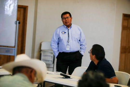 Darryl Bradley, a civil engineer with the Navajo Division of Transportation, speaks Monday during a Tribal Transportation Improvement Program Public Hearing at the Nenahnezad Chapter house.