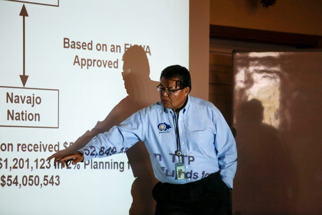 Darryl Bradley, a civil engineer with the Navajo Division of Transportation gives a presentation Monday during a Tribal Transportation Improvement Program Public Hearing at the Nenahnezad Chapter house.