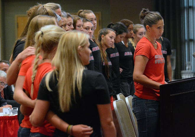 New Mexico beach volleyball player Abbey Willison speaks, standing in front of teammates, at the university's Board of Regents meeting Friday, Aug. 17, in Albuquerque.