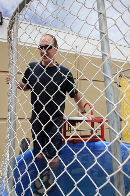 Brad Treptow challenges staff to dunk him on staff appreciation day.