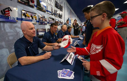 Young hockey fans meet coaches before the game at USA Hockey Arena.