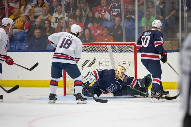 Goalie Dylan St. Cyr, a Northville High School graduate, stretches out to deny former Detroit Red Wing Patrick Eaves (18) during the Stars & Stripes Showdown.