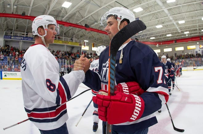 Following Sunday afternoon's Stars & Stripes Showdown in Plymouth, Detroit Red Wings teammates Justin Abdelkader (left) and Dylan Larkin greet each other in the handshake line.