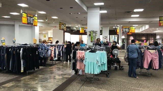 ad8c4a2e575 A few racks of clothing were left as customers found discounts up to 90  percent off