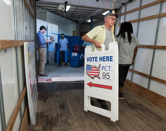 The Supervisors of Election's Office staff and other work crews load supplies for Tuesday's election onto trucks for delivery to local precinct polling stations in Escambia County on Monday, Aug. 27, 2018.
