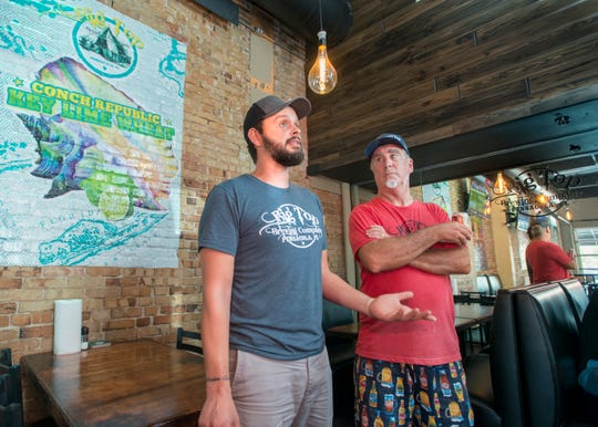 General manager Patrick Maus, left, and chef Dano Dunn talk about the new Big Top Brewing Company on W. Romana Street in downtown Pensacola on Monday, August 27, 2018.