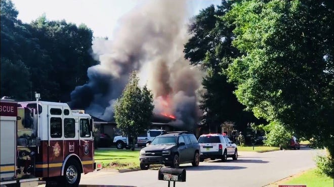 A house on BanBerry Road burns as Escambia County Fire Resuce works to put out the flames on Sunday, Aug. 27, 2018.