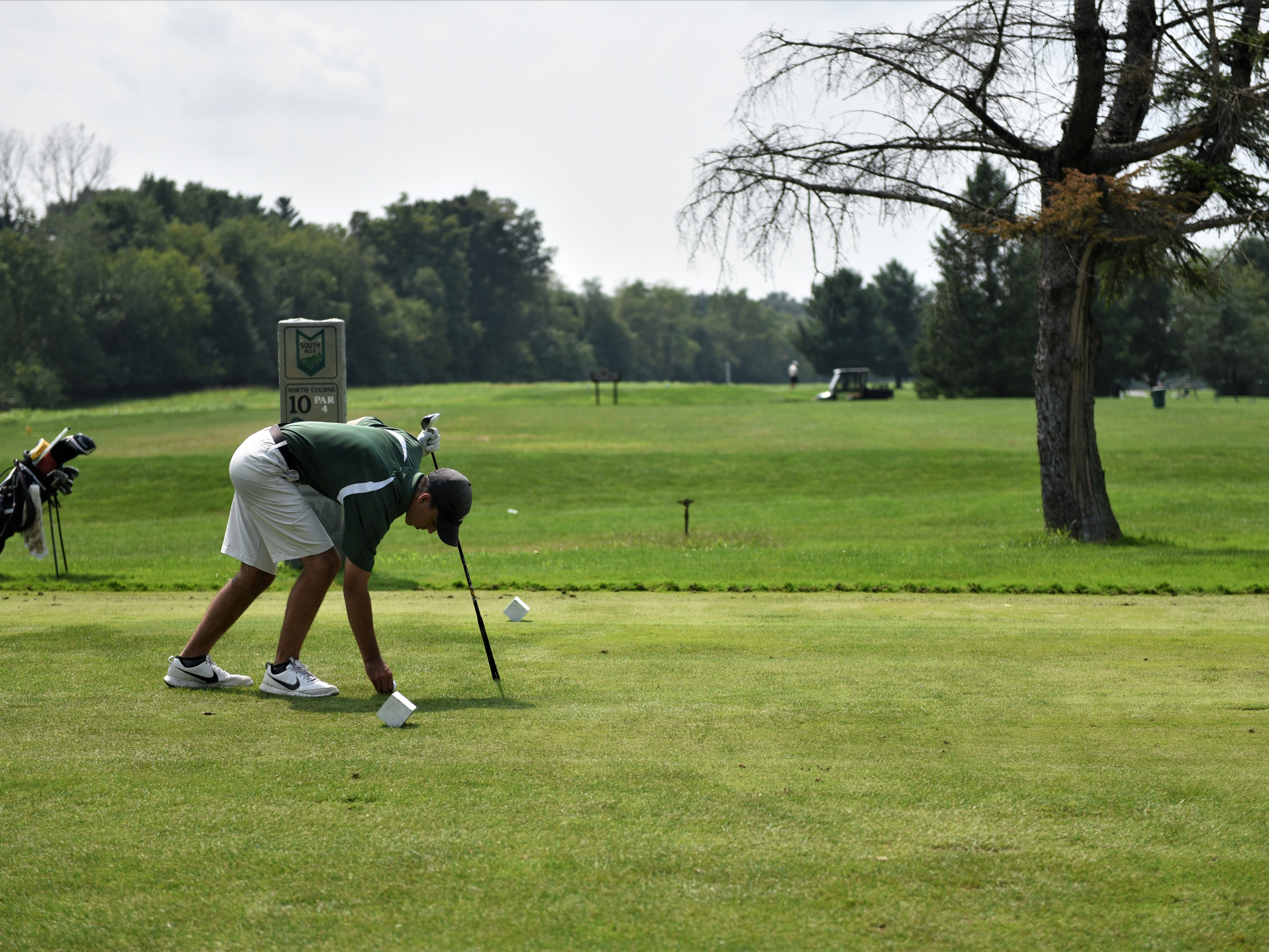 Alex May, of York County Tech, sets up his tee during the Division III golf match at the South Hills Golf Course on Aug. 27, 2018.