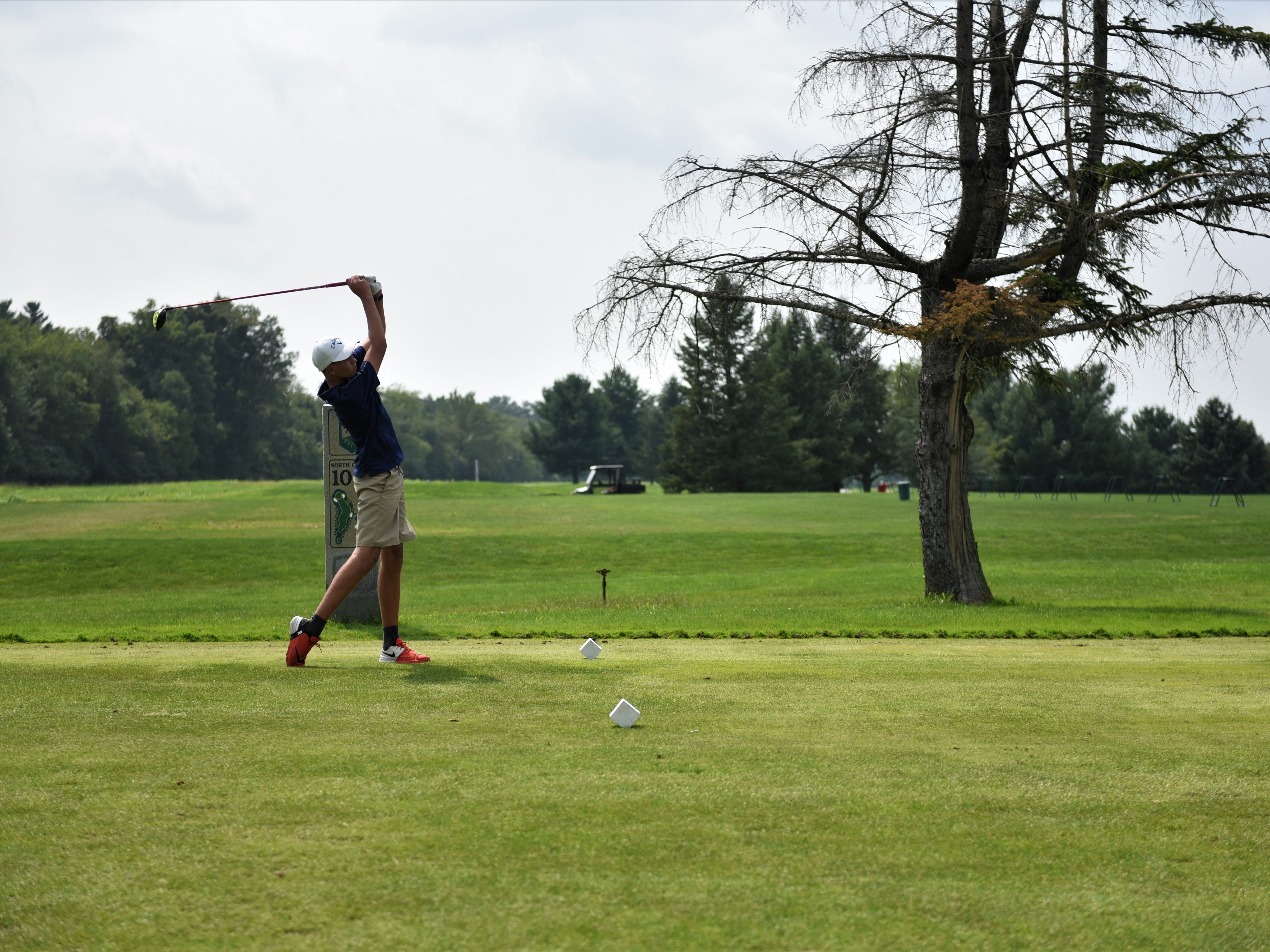 Biglerville's Daniel Hartman, tees off on the 10th hole during the Division III golf match at the South Hills Golf Course on Aug. 27, 2018.