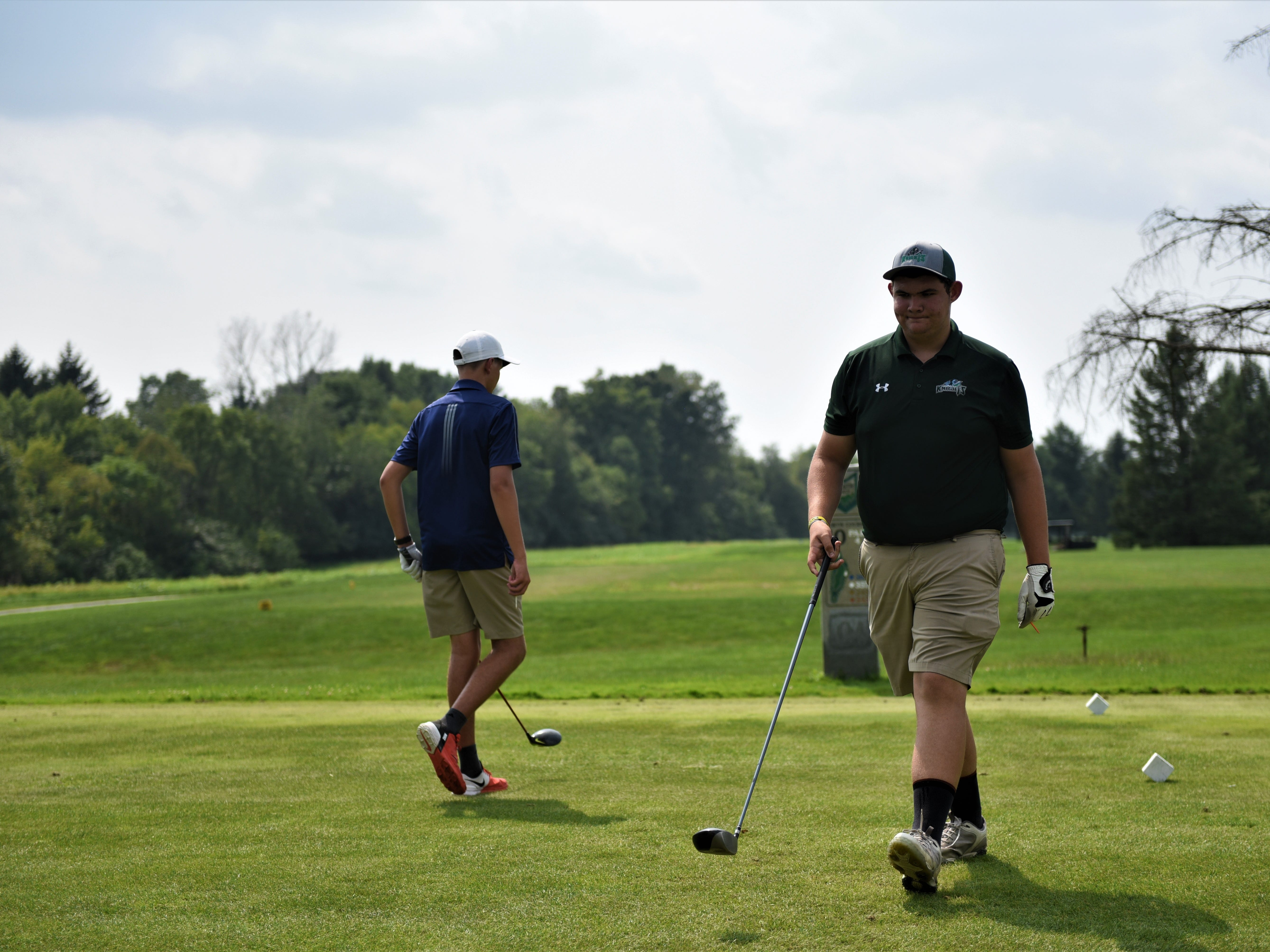 Fairfield golfer Greg Gripe walks off after teeing off during the Division III golf match at the South Hills Golf Course on Aug. 27, 2018.