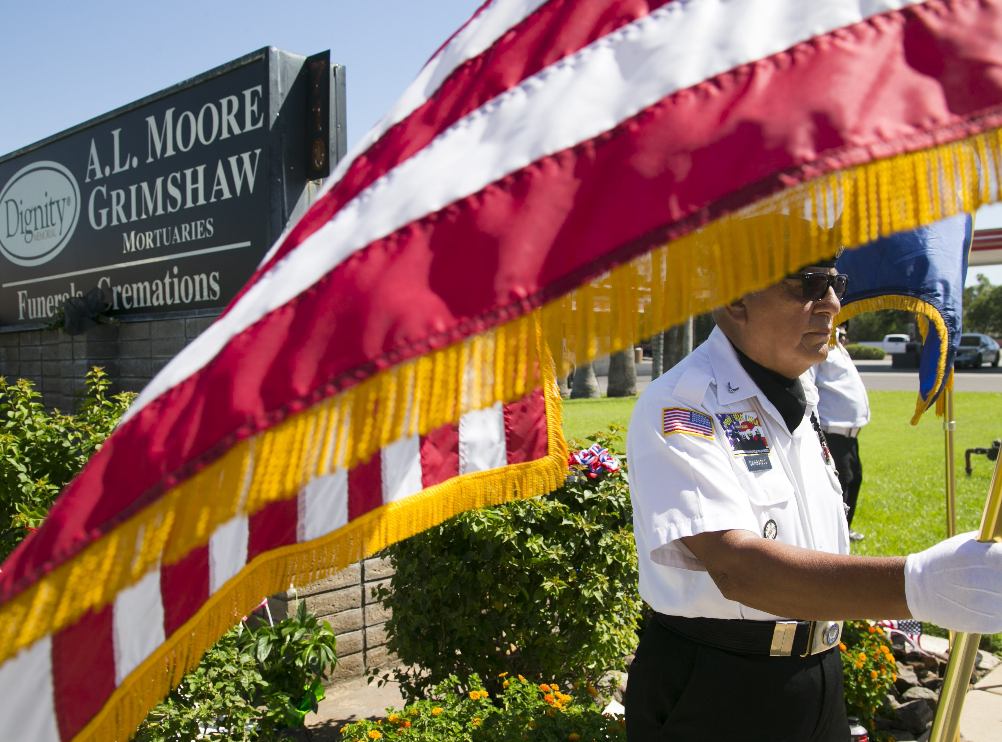 David Carrasco, the Commander of the POW MIA KIA Honor Guard, stands guard by a memorial for Sen. John McCain at A.L. Moore-Grimshaw Mortuaries in Phoenix, on Aug. 27, 2018.